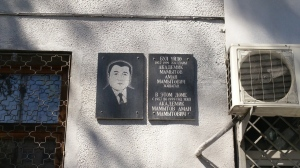 Plaque showing that scientist Aman Mamytov lived in this building from 1957-1999. Mamytov is best known for creating a new genre of investigating mountain soils.